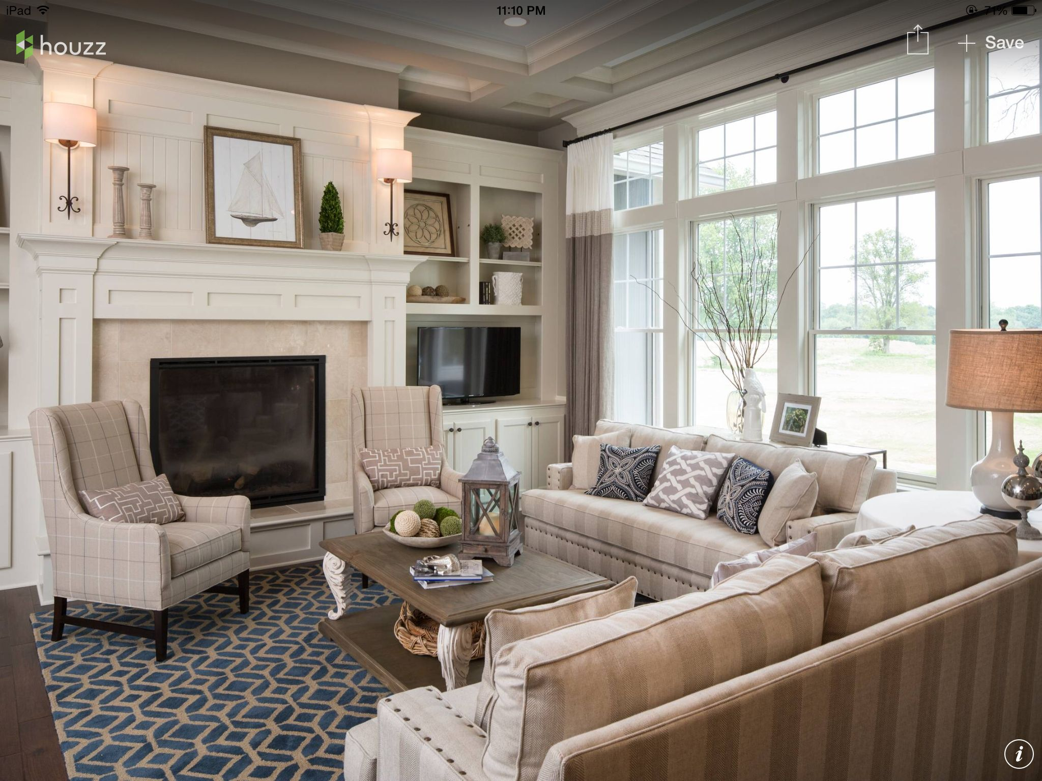 Family Room Feels Sophisticated And Also Very Cozy, With Its Navy Blue  Accents. The Fireplace Surround Is Cardinal Beige Marble Tile.