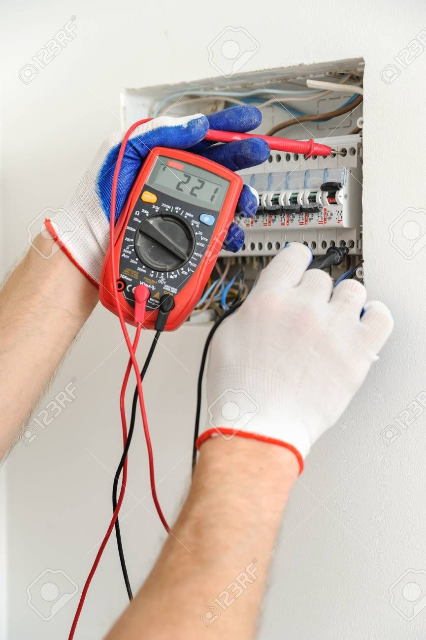 electrician check voltage in electrical fuse box with a multimeter ...  pinterest