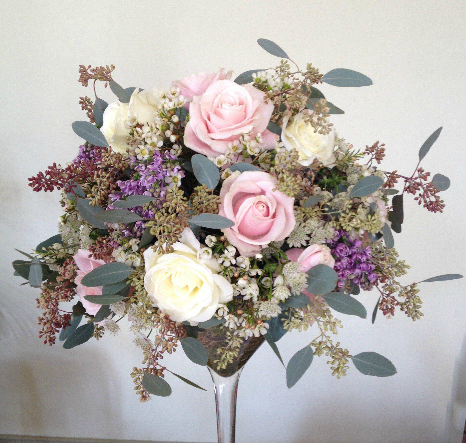 Flower arrange in wine glass high level centrepiece martini flower arrange in wine glass high level centrepiece martini glass arrangement with soft pinks reviewsmspy