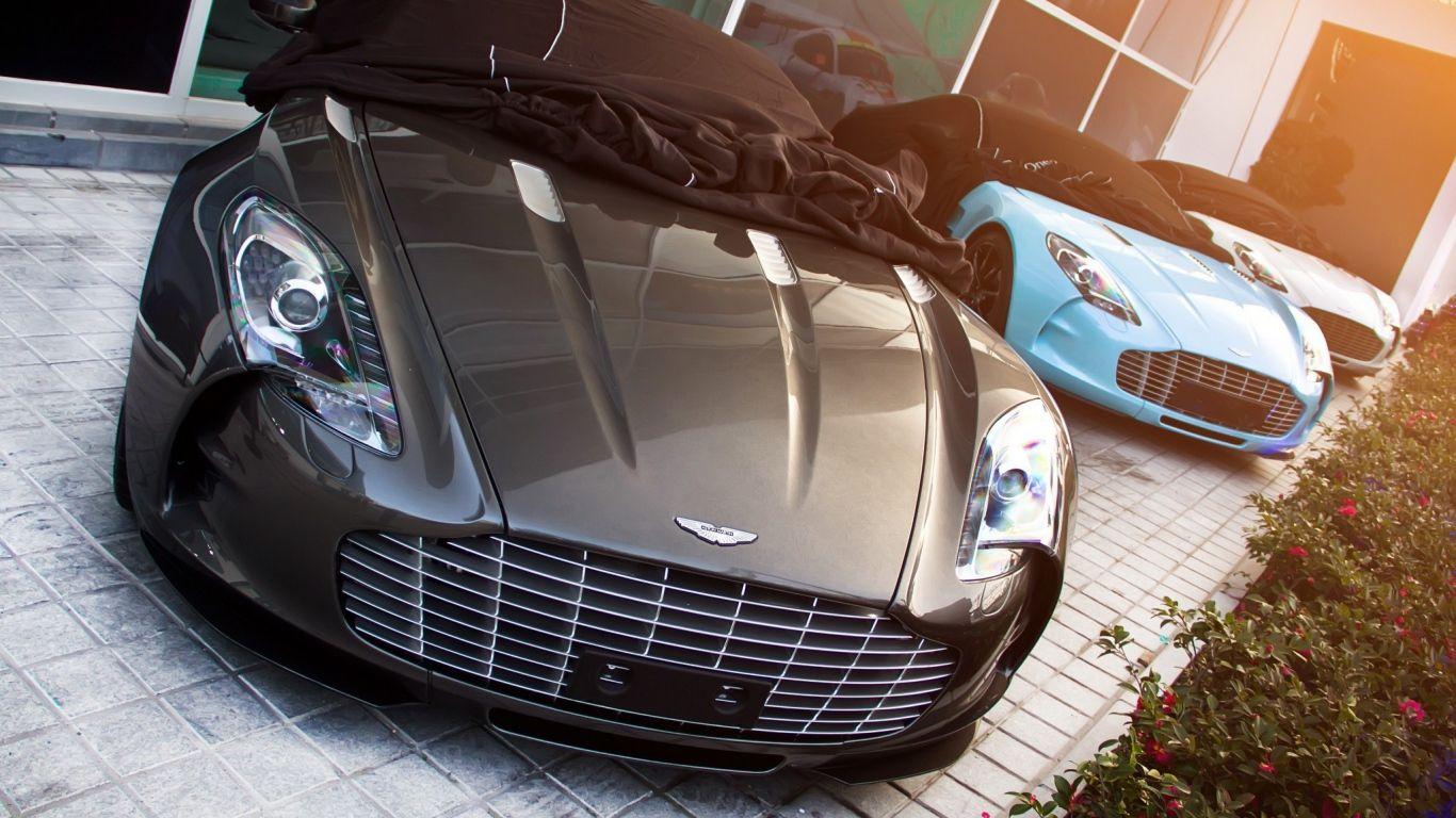 Download Wallpaper 1366x768 One 77 Aston Martin Supercar Light Top View Laptop 1366x768 Hd Background Aston Martin Aston Martin Cars Super Cars