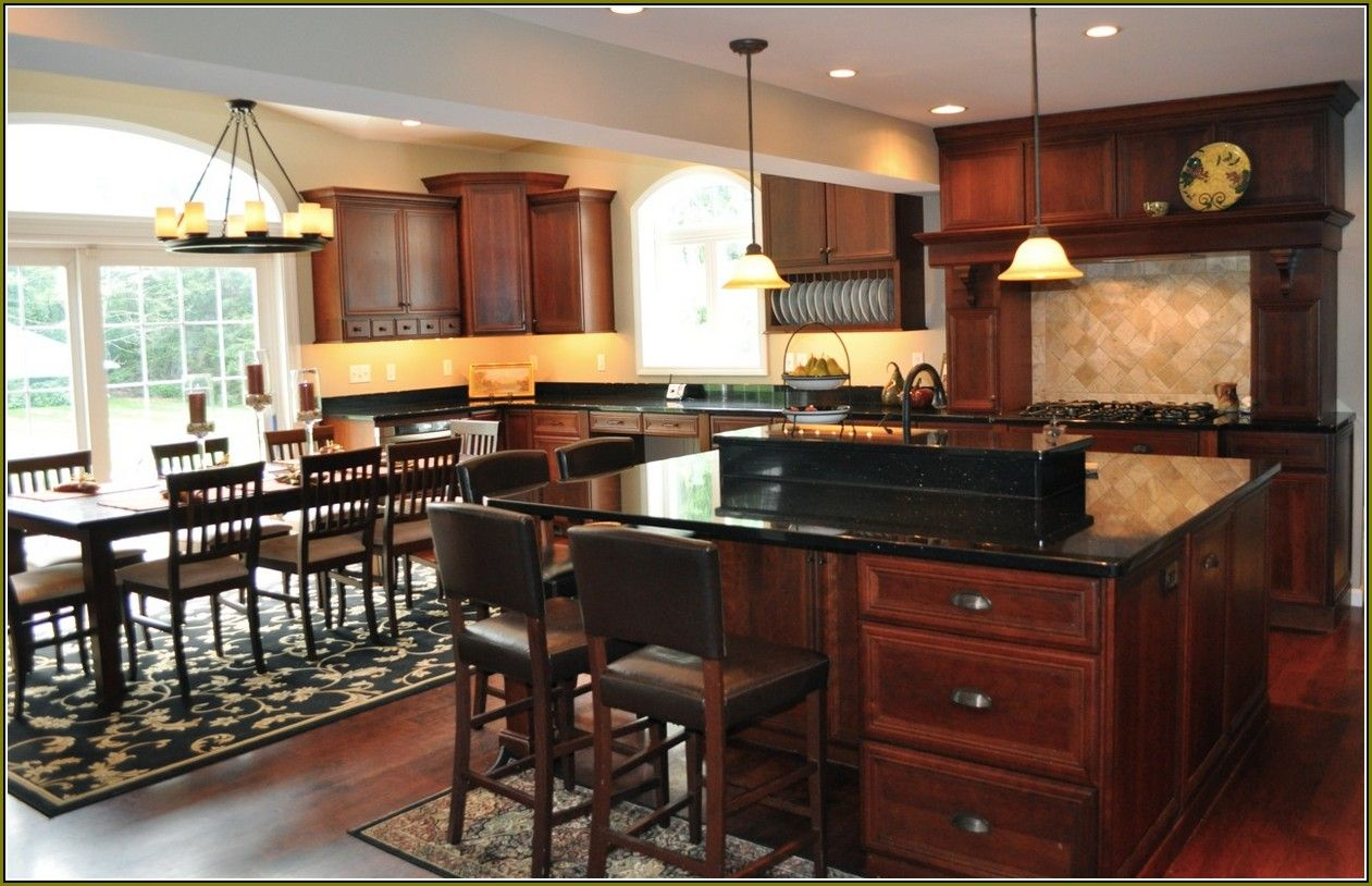 Cherry Kitchen With Black Granite Countertops