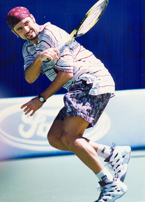 brand new eb84a d4c50 Agassi in his Nike Tennis clothes at the 1995 Australian Open. He debuted  this whole look, complete with the shaved head and bandanna, here after  years with ...