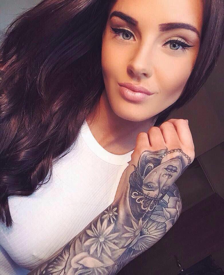 Tattoo, hair, make up. Everything