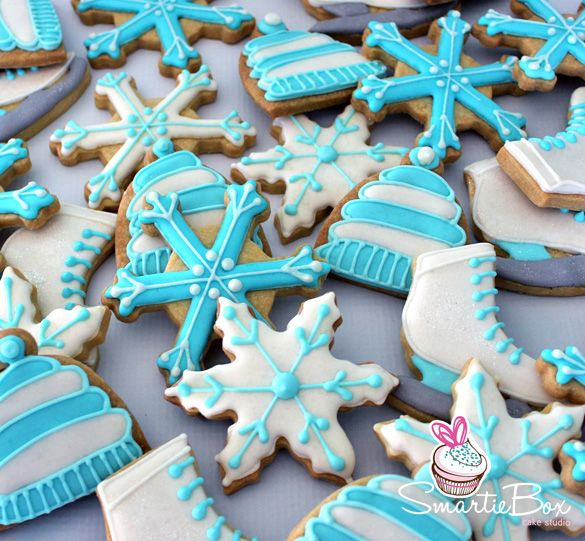 Ice Skating Cookies, with snowflakes, hats and ice skates in blue and white - SmartieBox Cake Studio