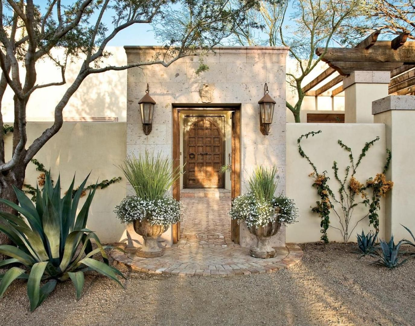 Spanish colonial entry courtyard features a cantera for Courtyard in front of house