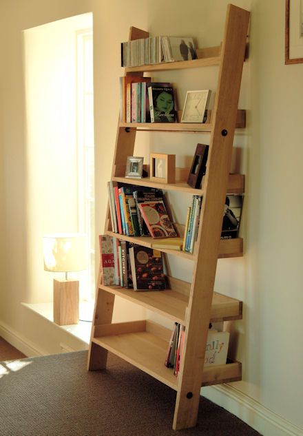 Large Oak Ladder Shelf at Store. Free-standing oak shelving unit with six  tray-shelves to store books etc.