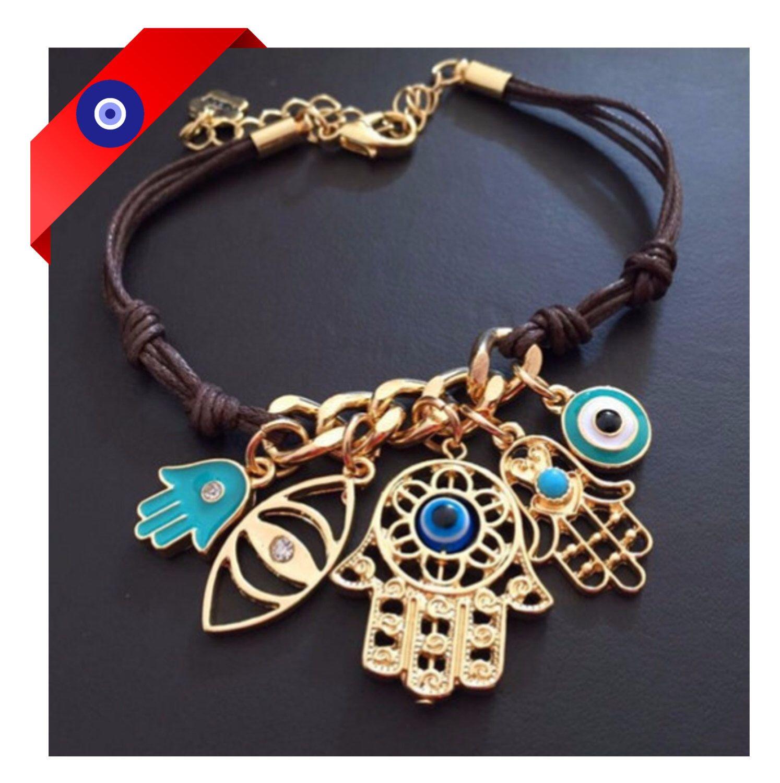 Evil Eye Hamsa Bracelet - Evil Eye Charms Bracelet - Hamsa Charms Gold Turquoise Charm Bangle Bracelet - Protection Charm Bracelet by LouluJewels on Etsy https://www.etsy.com/listing/259110363/evil-eye-hamsa-bracelet-evil-eye-charms