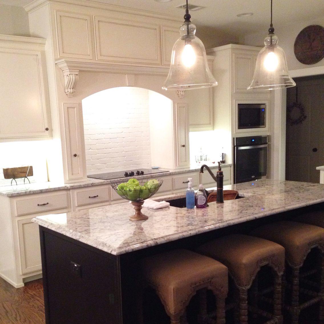 Kitchen With Painted Brick Backsplash West Highland White Cabinets White  Ice Granite
