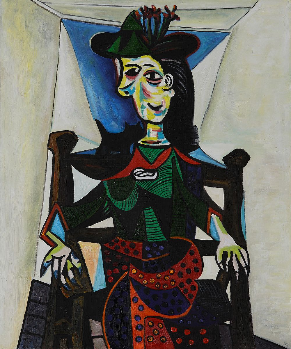 """Picasso's """"Dora Maar with Cat"""" (1941). It depicts Dora Maar, Picasso's lover, seated on a chair with a small cat perched on her shoulders. One of the most expensive paintings, sold for $US95M"""