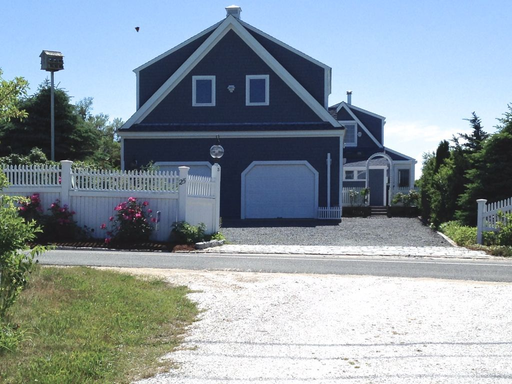 Birds eye view of cape cod bay waterfront home with