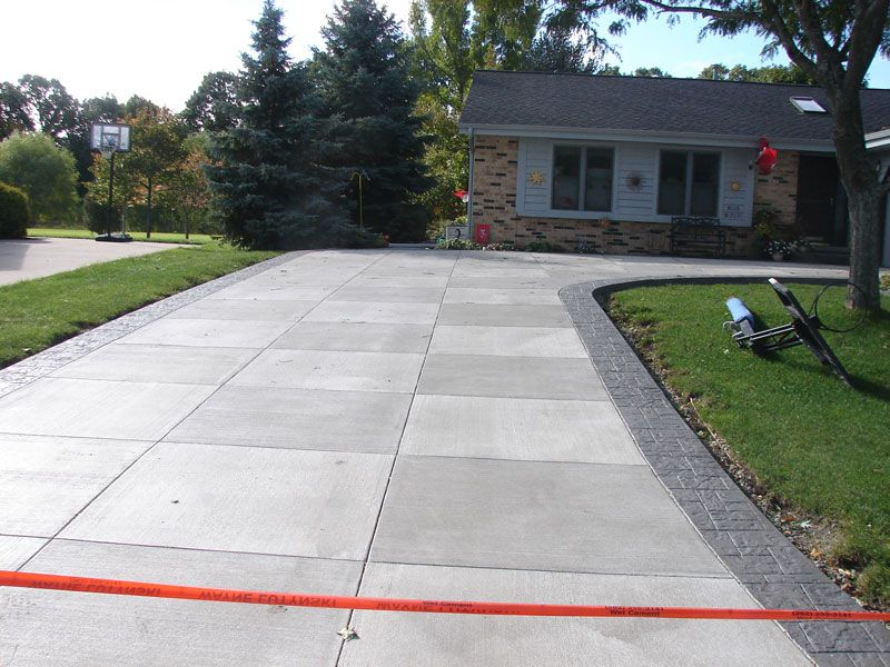 Concrete Driveway Design Ideas choose two types of patterns or finishes to give your driveway a unique look in this example exposed aggregate was used in the fields and a patterned Scored Modern Concrete Driveways Without The Stamped Side Boarder