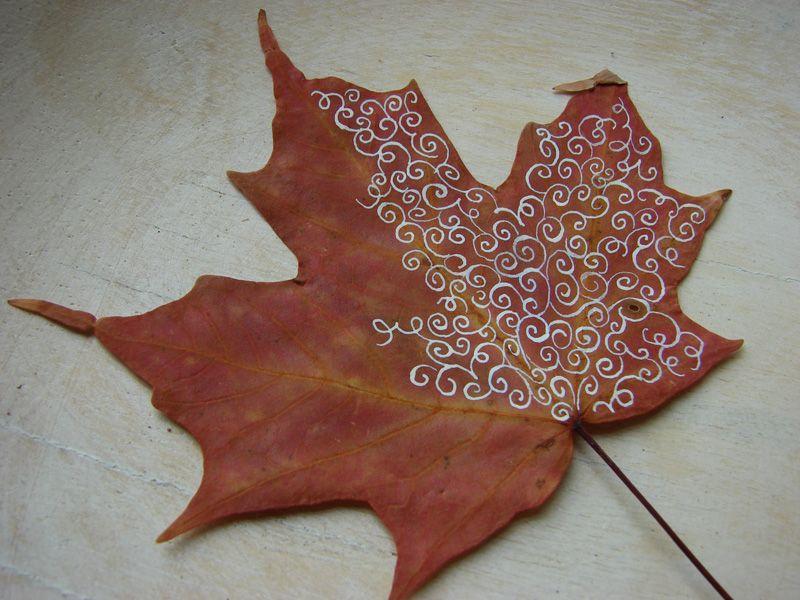 metallic paint on an autumn leaf.