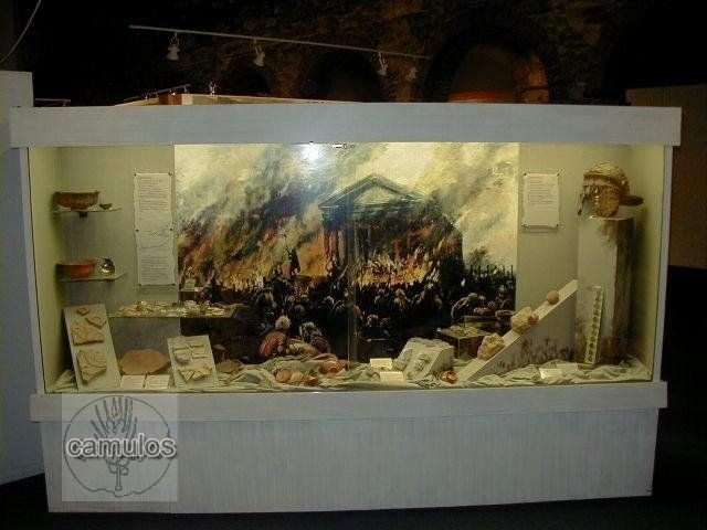 A display cabinet devoted to the Boudiccan rebellion, showing the destruction of the Temple of Claudius in or around AD 61.