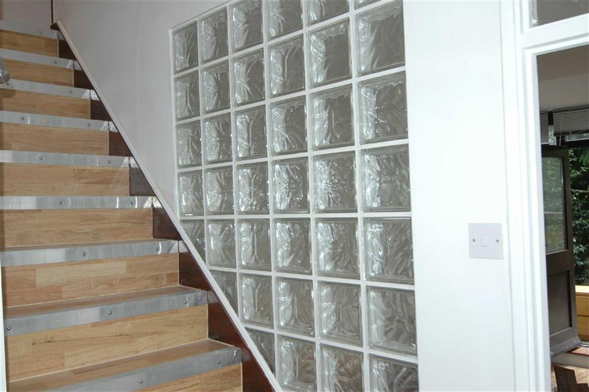 Glass block wall between living room and stairs new - Glass block windows in living room ...