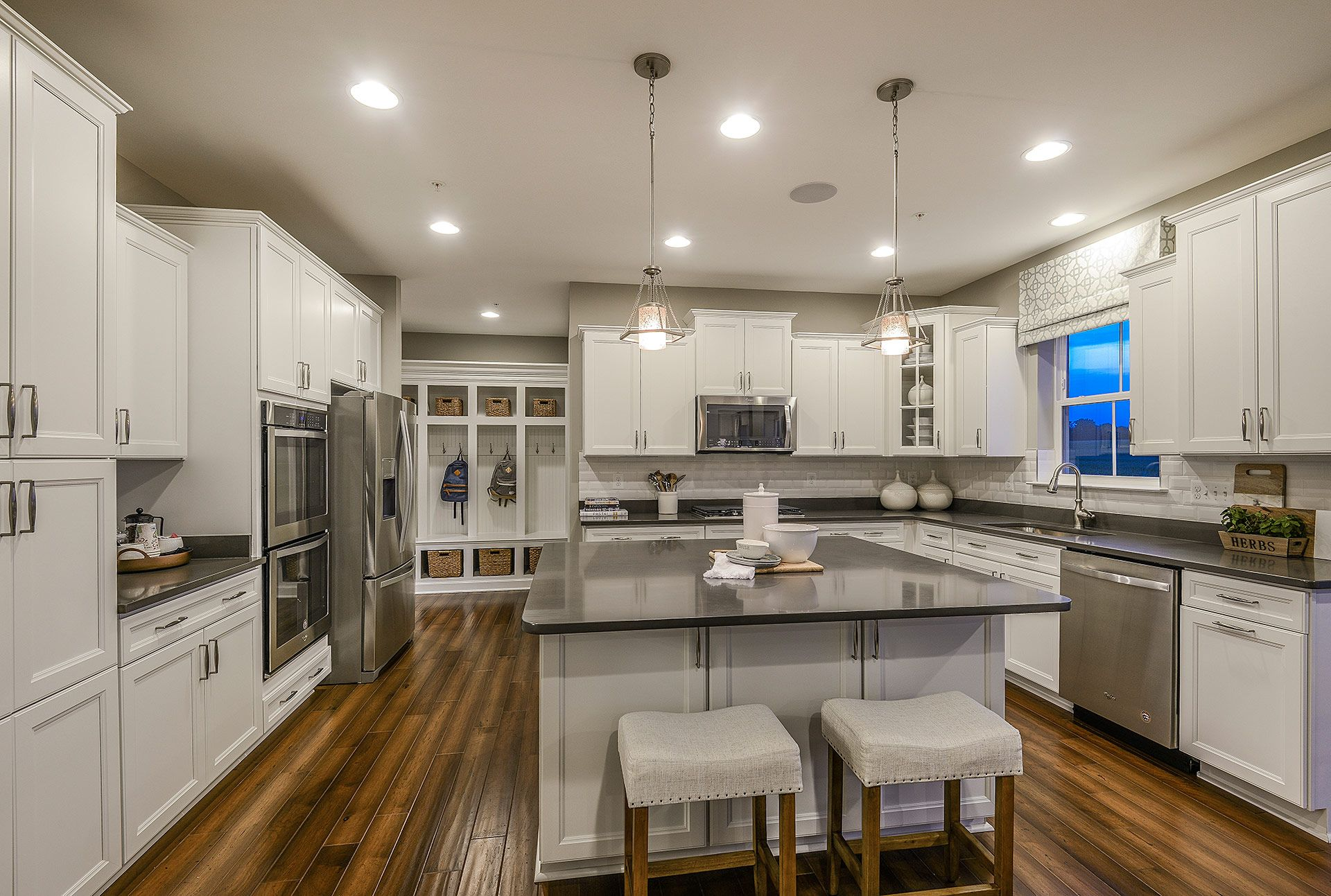 ... Contemporary Kitchen Inside The Columbia Model At Eastchurch In  Frederick, MD. The Gorgeous Dark Granite Countertops Contrast Perfectly  With Glossy ...