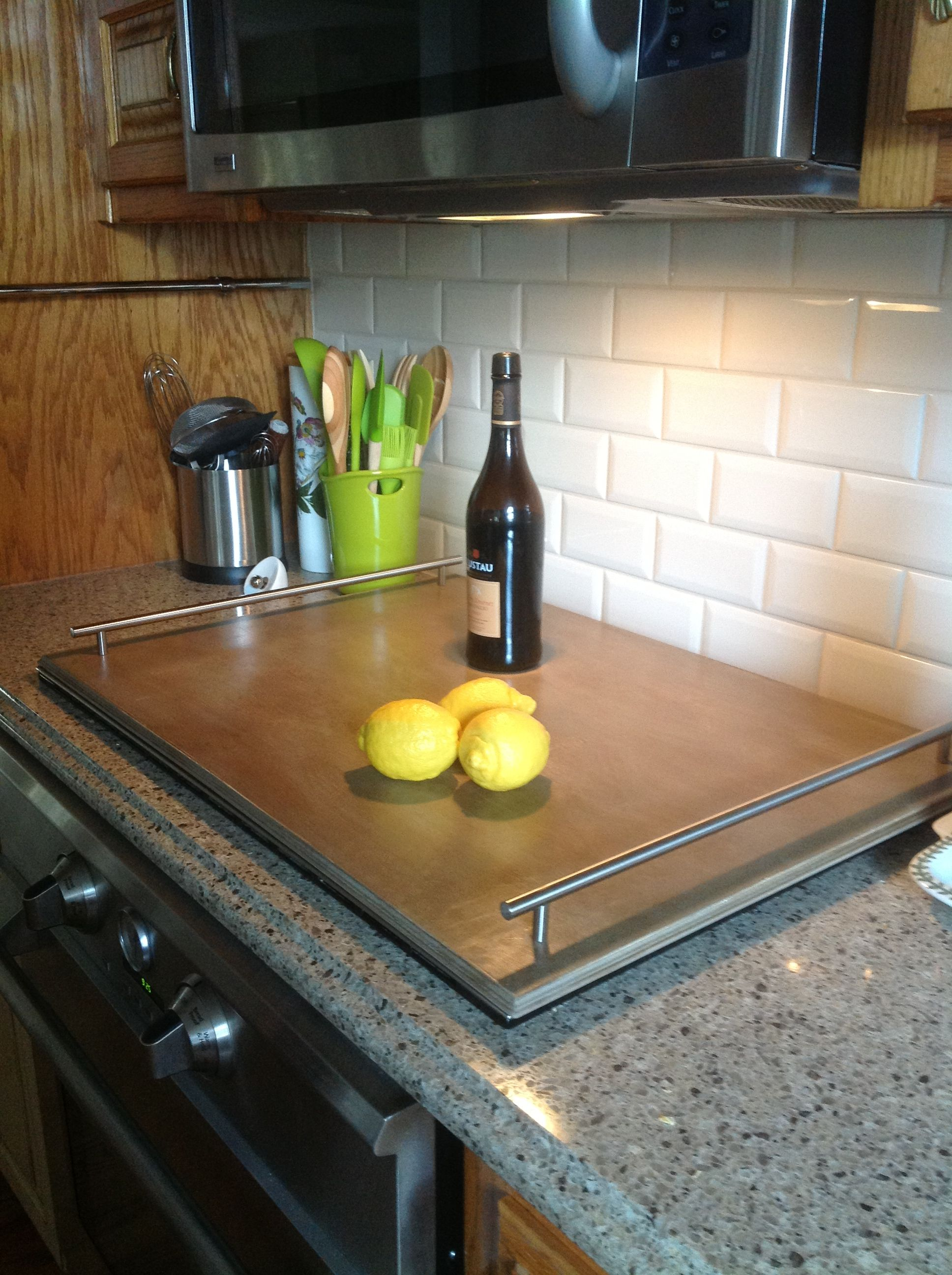 Induction cooktop cover. Wood from Lowes cut to fit. Oversized pulls ...