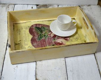 This serving tray is made from wood, decorated with acrylic paints, decoupage and protected with varnish. This tray would look great in any kitchen or setting on an ottoman like beautiful decoration. Would make a great wedding gift or housewarming gift. This tray measures: 12 inch Length X 9 inch Width X 2,5 inch Height (30,5 cm Length X 22 cm Width X 6 cm Height) To clean this tray just wipe with a damp cloth. Please do not put in water or the dishwasher and do not put hot things on the…