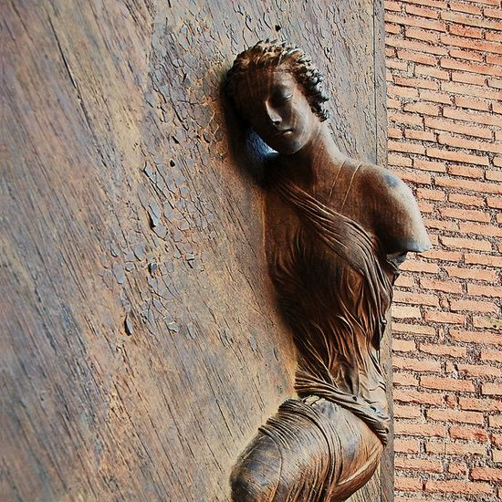 woman with no arms relief church door basilica of st mary of the