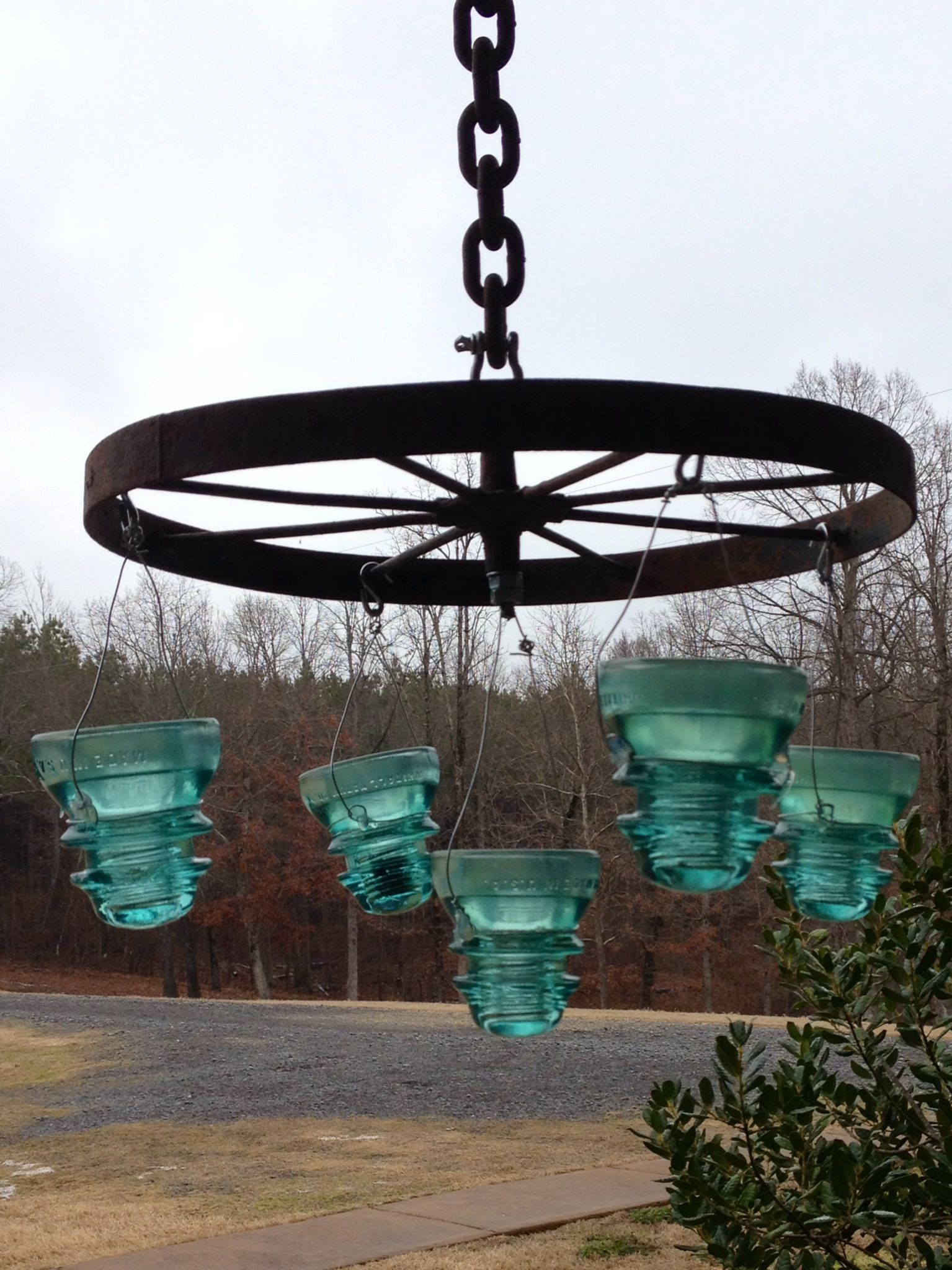 Diy outdoor chandelier an old plow wheel and glass insulators just diy outdoor chandelier an old plow wheel and glass insulators just add tea lights arubaitofo Images
