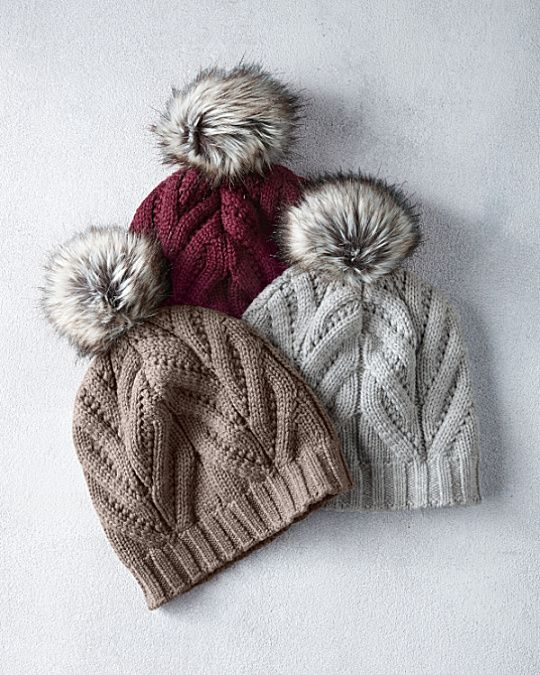 Topped with an oversized faux-fur pom-pom, this chunky cable-knit hat is a perfectly playful way to finish your look. Stylish and warm in soft, breathable merino wool.