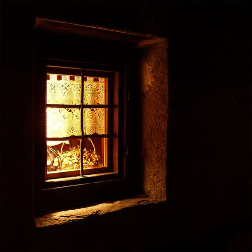 Looking Through A Window Filled With Amber Night Light Draped In Lace Night Window Windows Cottage Windows