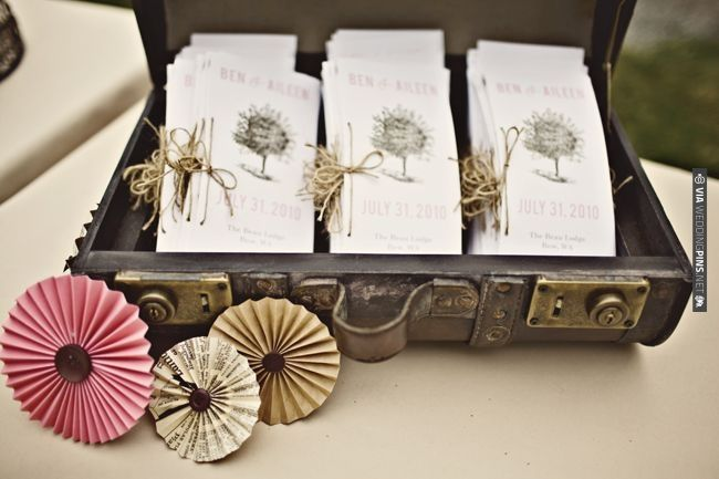 love the pinwheels - simply sheet music accordion folded with buttons attached either side   CHECK OUT MORE IDEAS AT WEDDINGPINS.NET   #weddings #diyweddings #diy