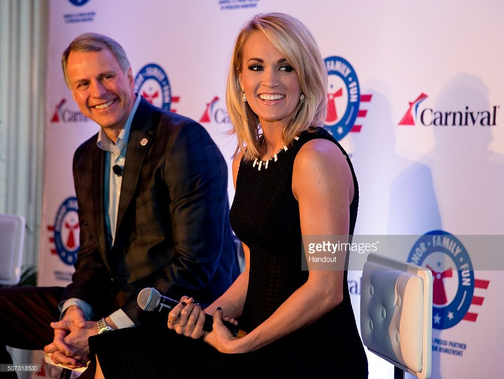 In this handout provided by Carnival Cruise Line, Carrie Underwood, right, reacts to a comment at a news conference Thursday, Jan. 28, 2016, in Jacksonville, Fla. At left is Brig. Gen. John Pray, president and CEO of Operation Homefront. Underwood, Operation Homefront and Carnival Cruise Line announced a partnership to begin a new initiative to support U.S. military families. The effort between the three entities is to raise funds through a series of projects during Underwood's concert tour…