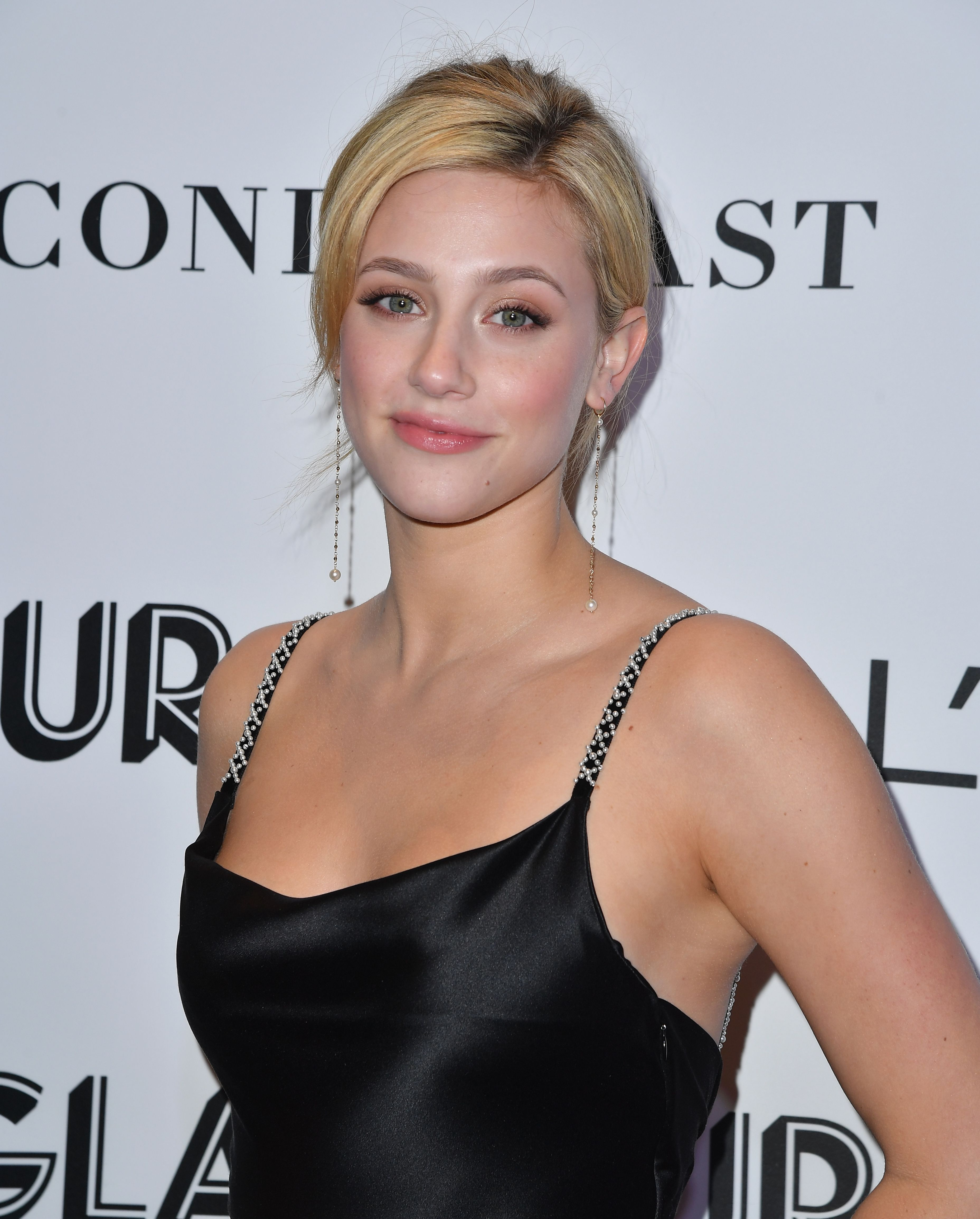 Lili Reinhart looks beautiful in a black dress on the red carpet. She will be starring in the upcoming movie 'Hustlers' alongside Jennifer Lopez and Cardi B. Photo Credits: Getty Images