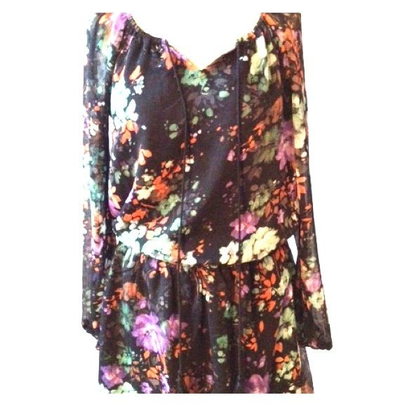 Jessica Simpson Painterly Flora Laurelle Dress With its soft floral print and sheer detail at the back and sleeves, Jessica Simpson's breezy dress masters sweet Summer style. Polyester, machine washable. Notch neckline with self tie at front. Pull on style, long sheer sleeves. All over floral print. Elastic band at waist. Relaxed fit. Hits above the knee Jessica Simpson Dresses