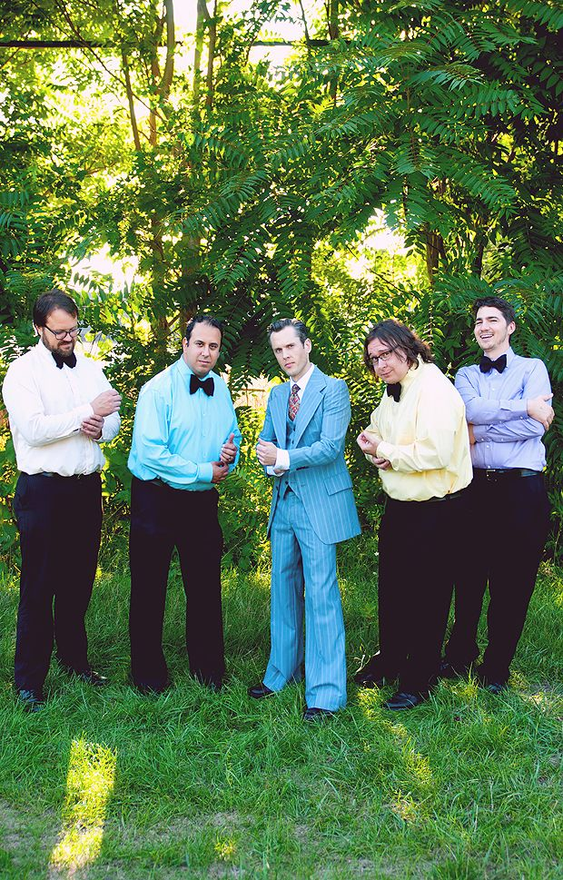Cammila and MC's Wedding -- 70's style groomsmen wear different colored pastel shirts with BIG bowties