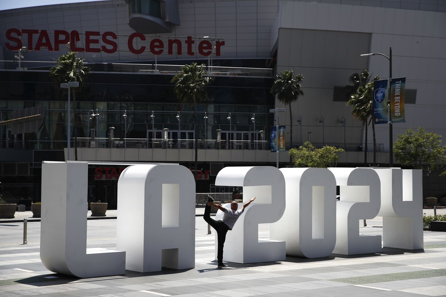 Yoga Instructor Michael Phillip Poses With A Los Angeles 2024 Sign Outside Staples Center Friday May 12 2017 In Los Ang Staples Center Olympics Los Angeles