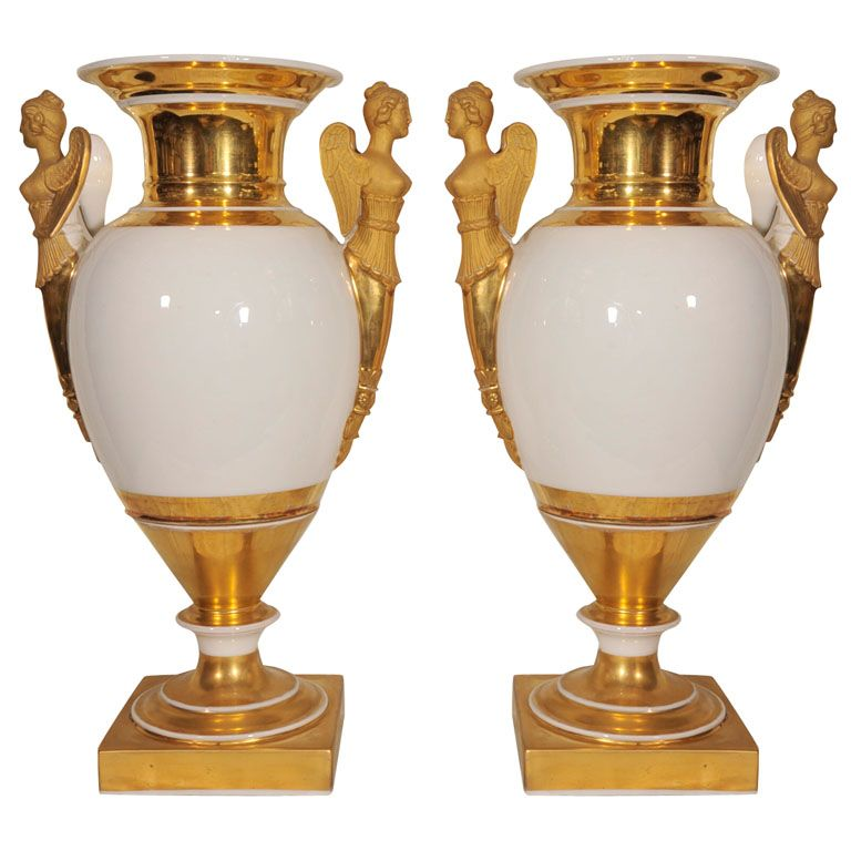 Pair Early 19th C French White / Gilt Paris Porcelain Vases  France  c1830  A pair of French, early 19th century, Paris porcelain, neoclassical vases of ovoid form flanked by upright handles with matt gold in the form of winged victory