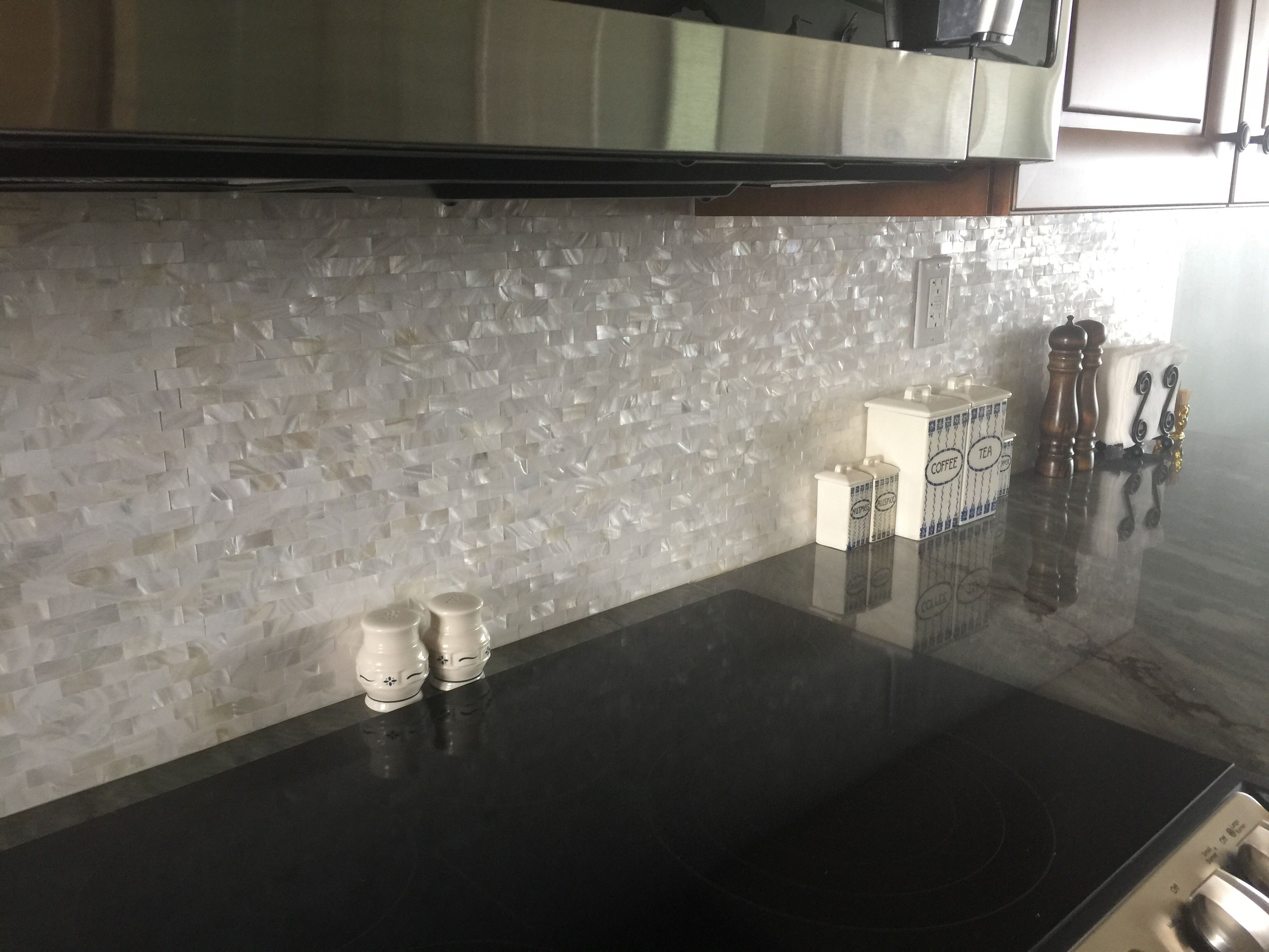 Beautiful Dancing Of Light And Er On This White Brick Groutless Pearl S Tile Backsplash