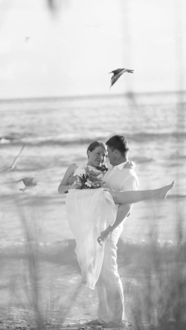 Married couple on the beach in Sarasota Florida.