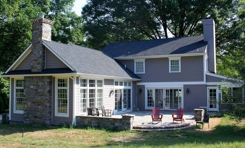 Updating a traditional two story house in delaware house for Two story sunroom additions