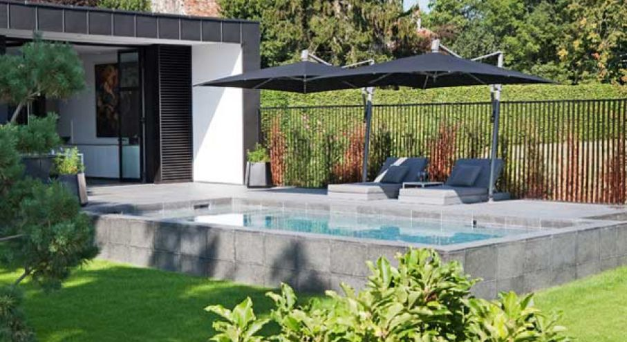 Piscine semi enterr e design piscines carr bleu for Bassin piscine pierre