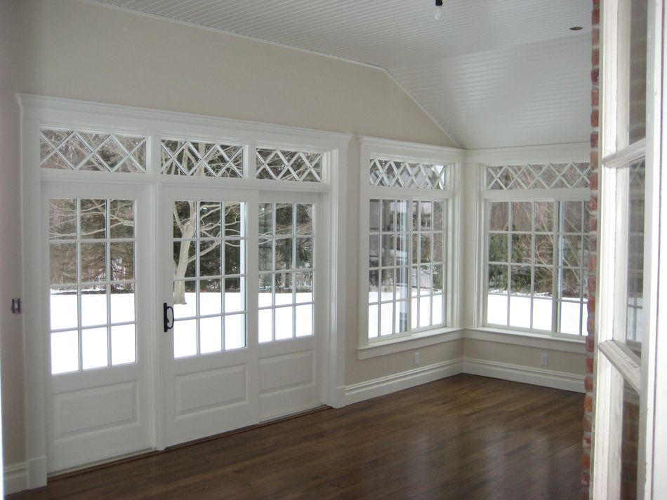 Pictures of sun rooms sunroom sunroom detail wainscoting for Sliding glass doors sunroom