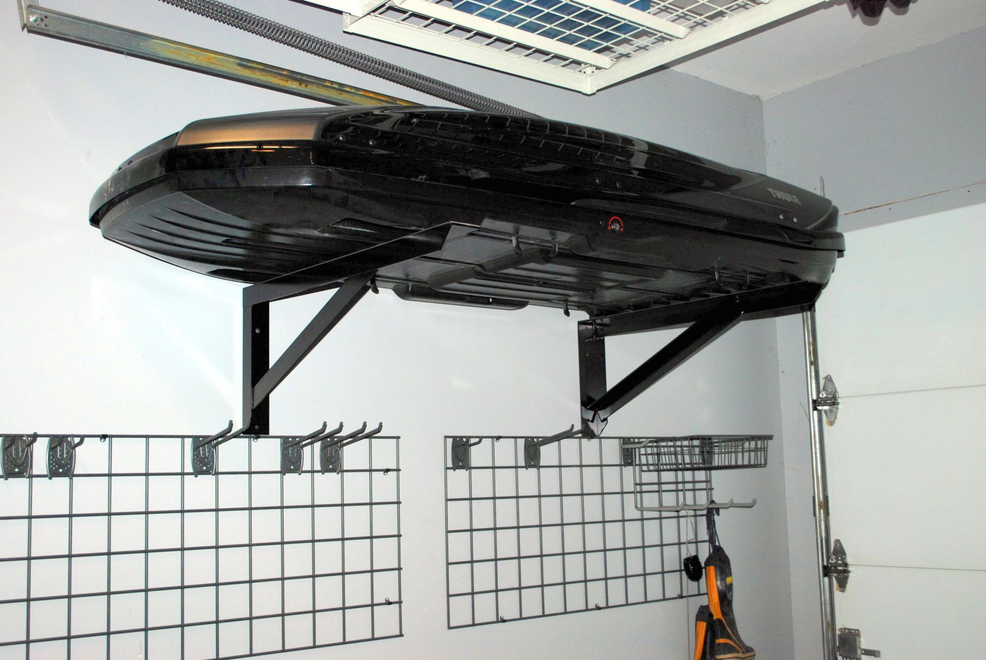 Find and install brackets to hang the roof box in the ...
