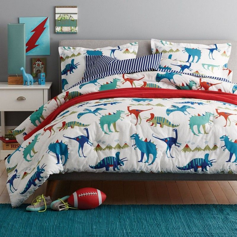 kids comforter with a ferociously fun dinosaur theme raptors triceratops and other dinos printed on soft cotton percale
