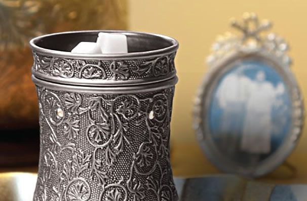 Love Scentsy products!  I have this warmer, Silvertine!  It is beautiful!