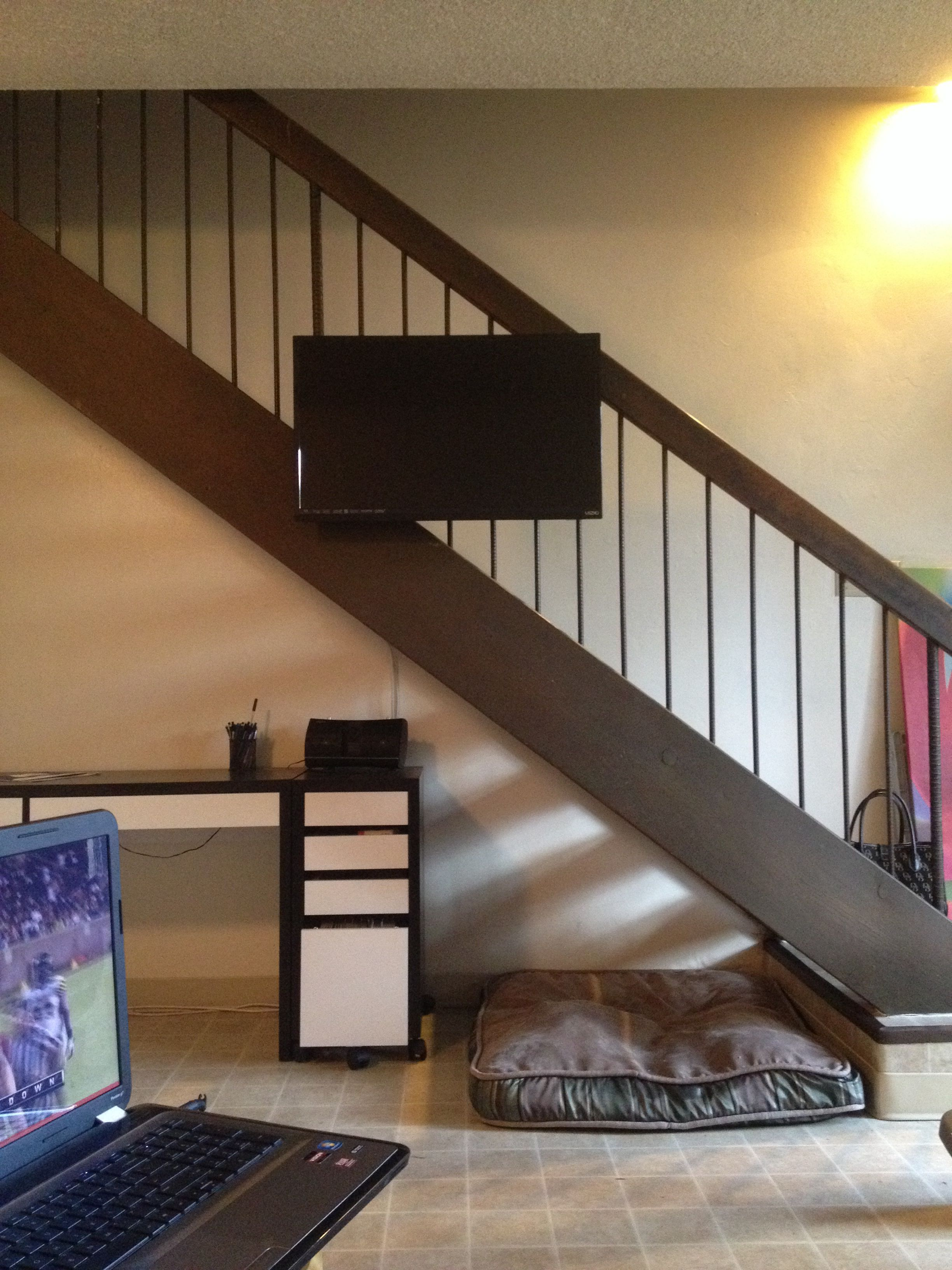 Small apartment? No problem. Mount your TV to the stairs ...