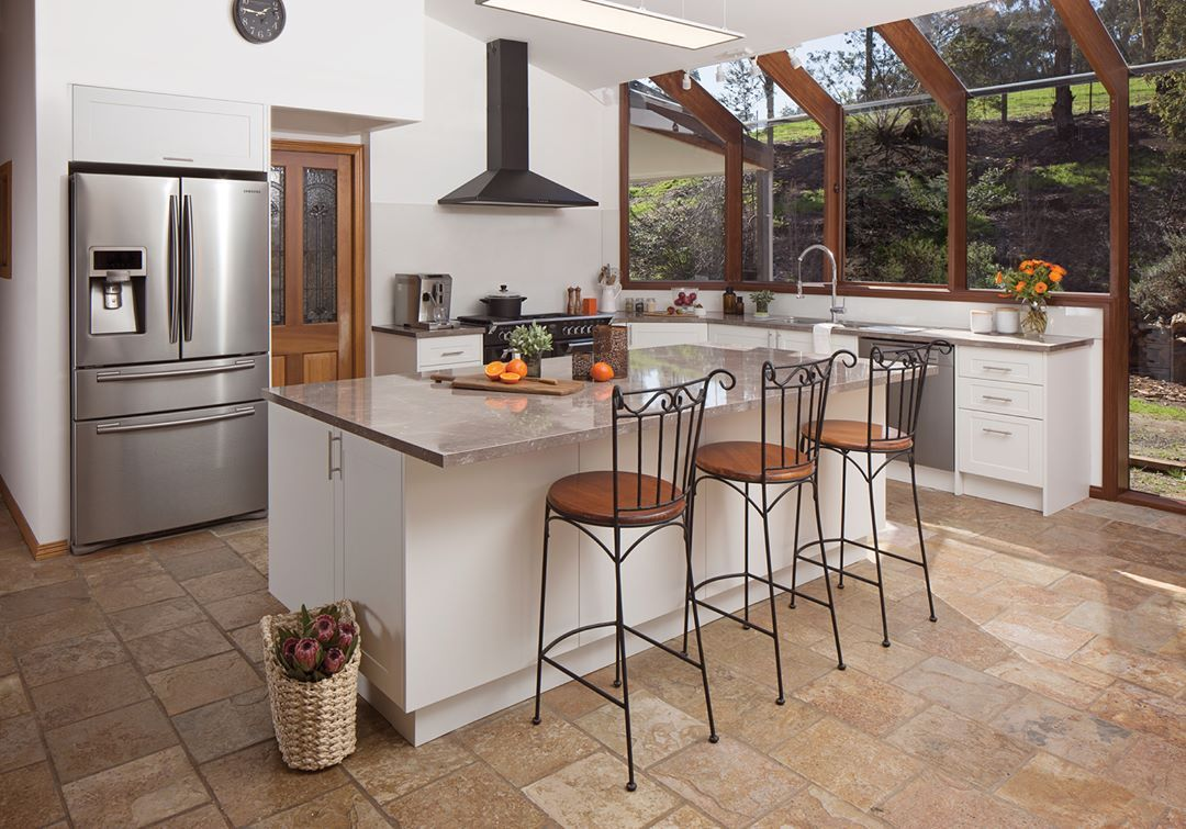 Use your kitchen to entertain in style! This bright, white