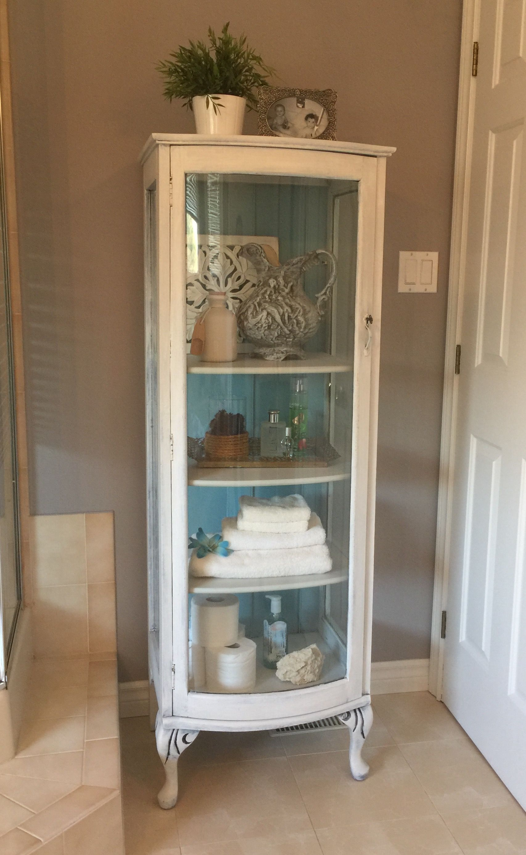 Small Curio Cabinet Painted With A DIY Chalk Paint. Painted White With A  Turquoise Backboard And Lightly Distressed. #shabbychicbathroomssmall
