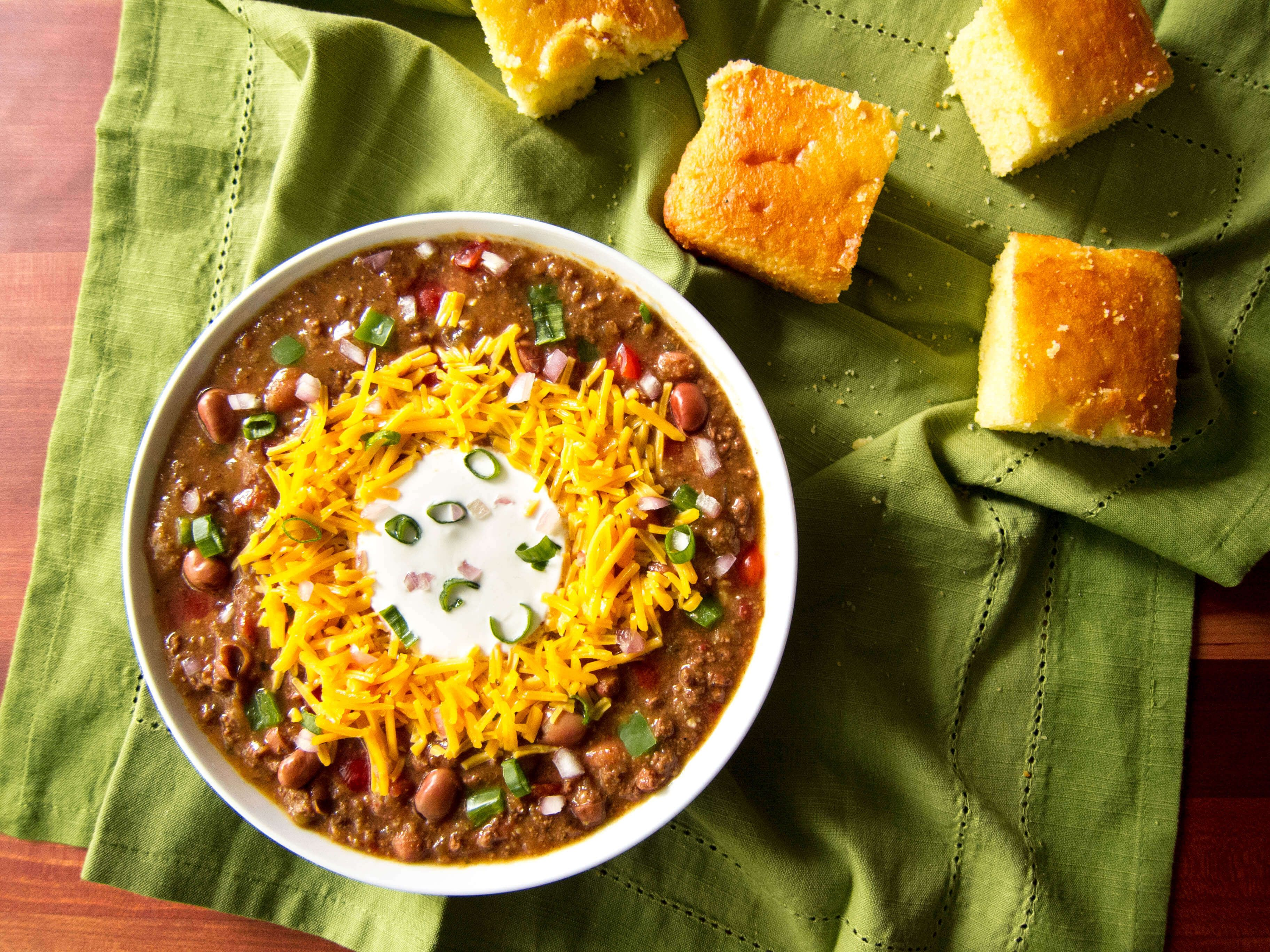 Instant Pot Chili, made using ground beef and dried beans, is the perfect comfort food for a fall or wintry evening. It's also a great dish to feed a crowd, or for game day. Masa Harina (corn meal) thickens the chili and gives it a corn flavor. Add your choice of toppings to take this chili over the top!
