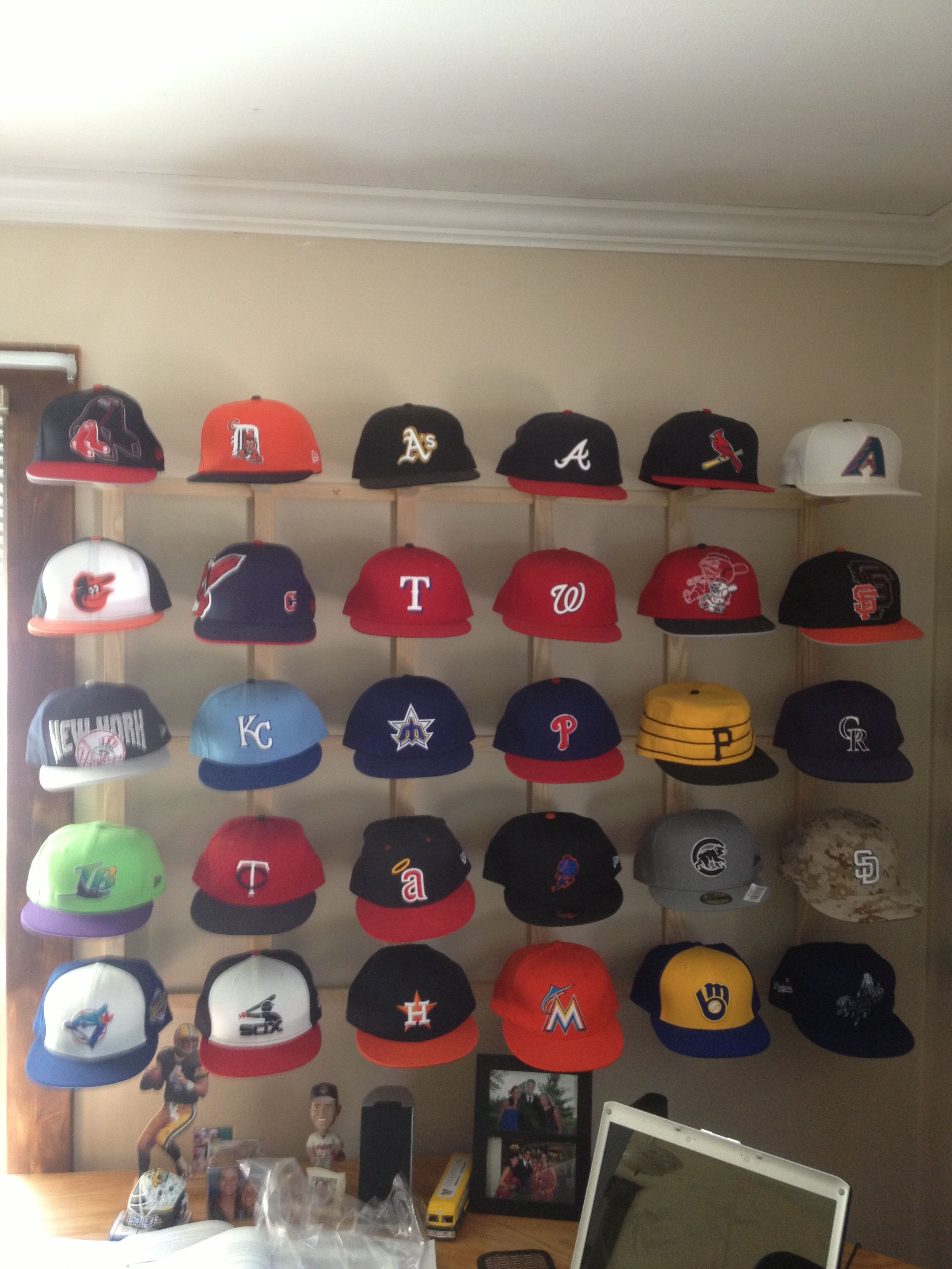 8372887d294bb My hat collection is complete... One hat from each team and a sweet way to  display it... I think my dad and I should patten this design