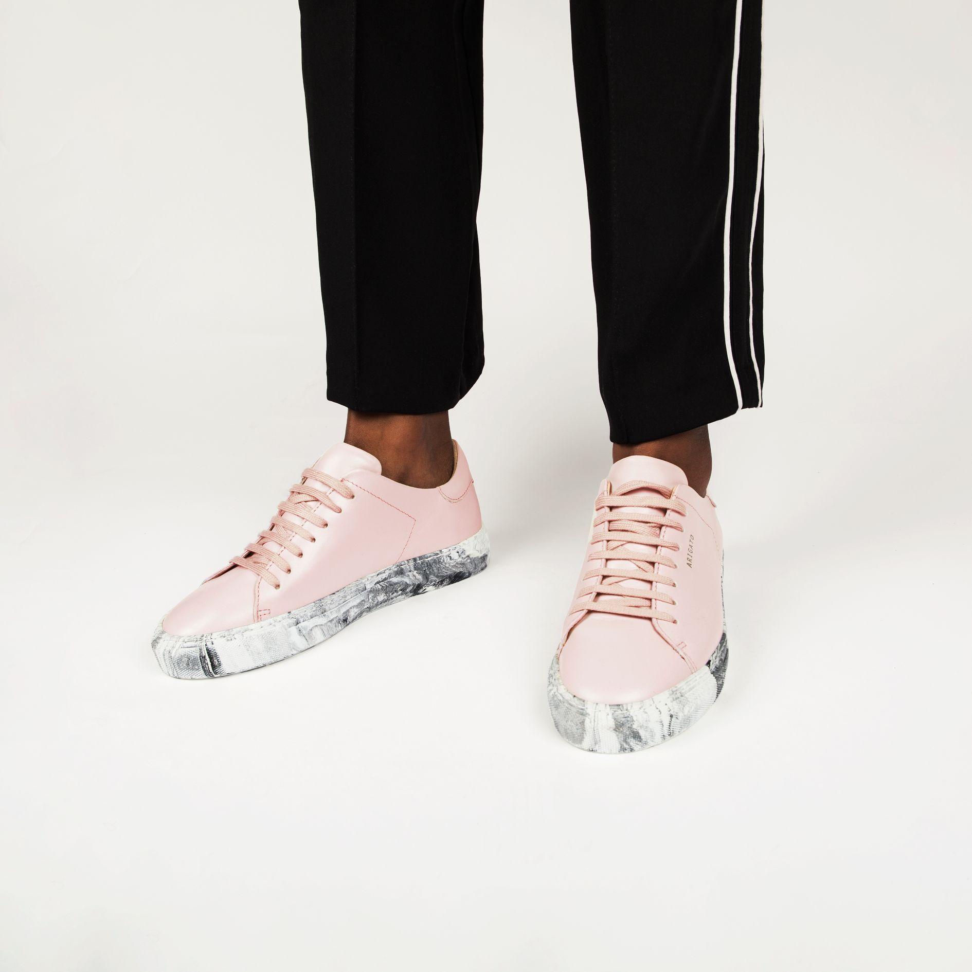axel arigato pink sneakers