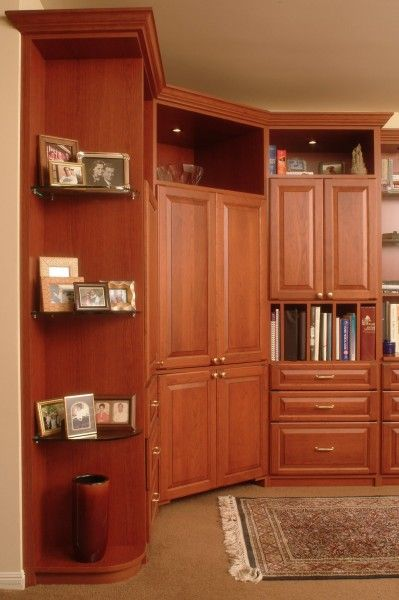 Cherry melamine entertainment center with floating shelves to display family photos!  Learn more: https://www.closetfactory.com/entertainment-centers/
