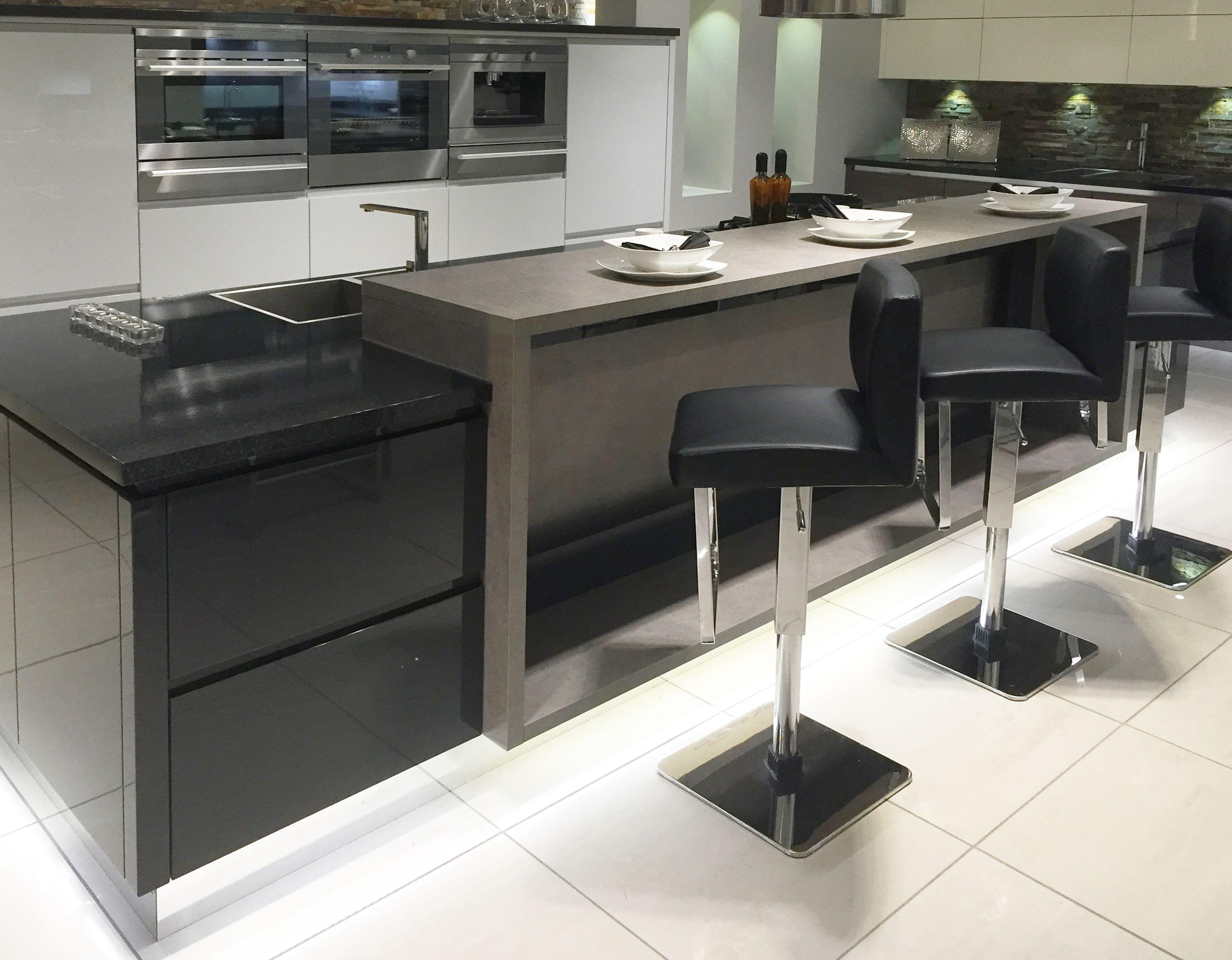 Modern Kitchen Island Design With Raised Breakfast Bar Area And