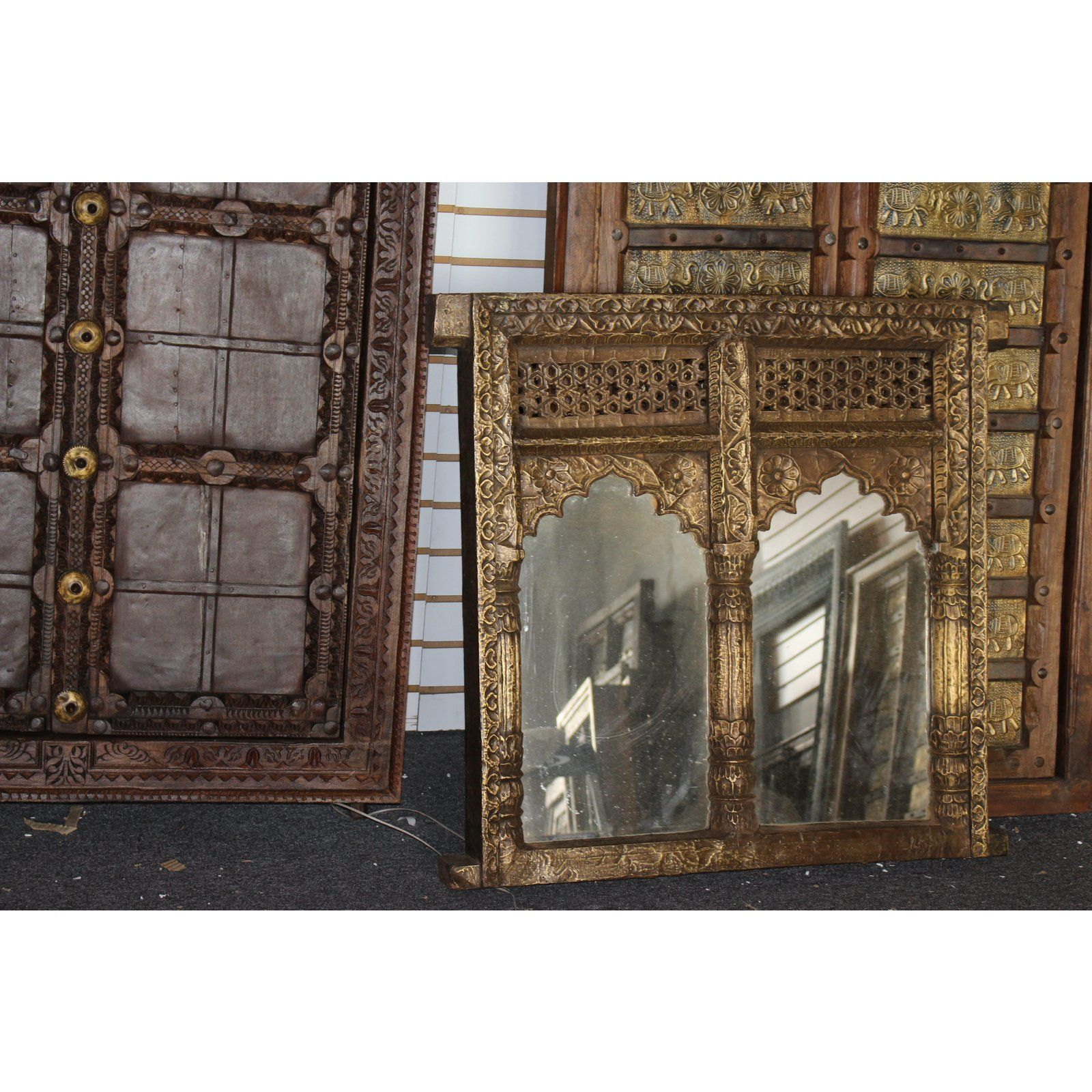 A Hand Carved Wooden Indian Mirror With Two Arched Profiles The