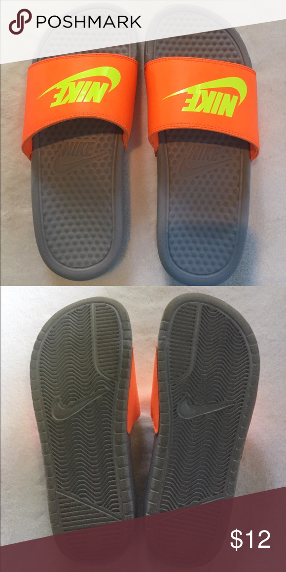 9ad56f80e23 Nike slides orange neon size 5Y Nike slides in orange neon. Size 5Y  (youth). Gently worn and in great condition. Nike Shoes Sandals   Flip Flops